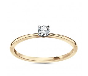 Staviori Pierścionek. 1 Diament, szlif brylantowy, masa 0,10 ct., barwa H, czystość SI1. Żółte, Białe Złoto 0,585. Średnica korony ok. 3,1 mm.