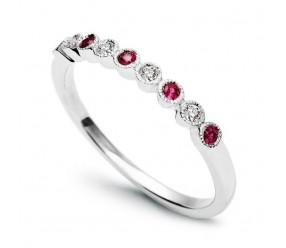 Staviori Pierścionek. 4 Diamenty, szlif brylantowy, masa 0,08 ct., barwa H, czystość SI2. 5 Rubinów, masa 0,16 ct.. Białe Złoto 0,585. Szerokość 1,8 mm.