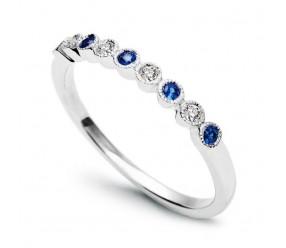 Staviori Pierścionek. 4 Diamenty, szlif brylantowy, masa 0,08 ct., barwa H, czystość SI2. 5 Szafirów, masa 0,15 ct.. Białe Złoto 0,585. Szerokość 1,8 mm.