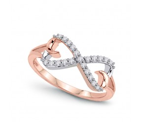Staviori Pierścionek. 21 Diamentów, szlif brylantowy, masa 0,18 ct., barwa H, czystość SI2. Białe, Różowe Złoto 0,585. Średnica korony ok. 7,2x16 mm. Wysokość 3,7 mm.