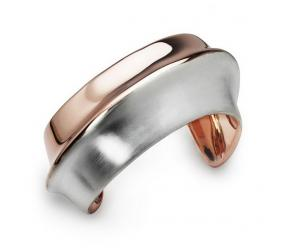 Staviori Bransoleta. Srebro 0,925.  pokryte różowym złotem Średnica 60 mm.   Zanurz się w ponadczasowym luksusie i załóż tę oszałamiającą, otwartą bransoletę z mankietami. Bransoleta jest wykonana ze srebra wysokiej próby 925 oraz pokryta ro&#